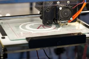 A 3D Printer in the middle of printing a ornamnet